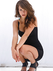 Malena Morgan on an impressive showcase   of her famed beauty, seductive   confidence, and erotic allure as she   flirts and strips her sexy black dre