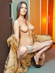 Vanda takes off her furry coat and bares   her meaty build with smooth skin, puffy   nipples, tight pussy and shapely legs.