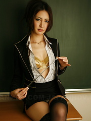 Julia Nanase dirty and naked in a classroom.